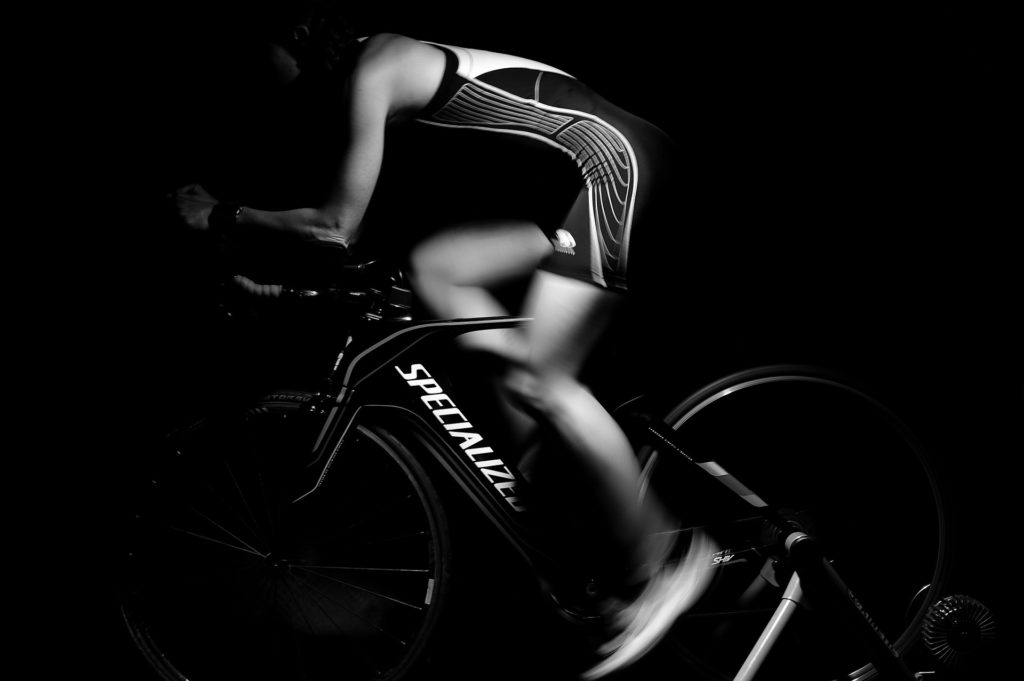 Black and white photo of a woman riding indoors