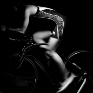 Black and white photo of woman riding indoors