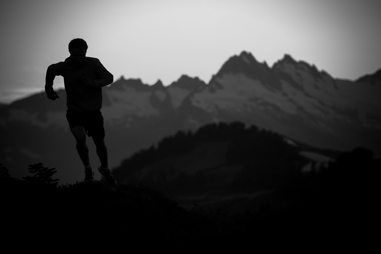 Athlete running through the mountains